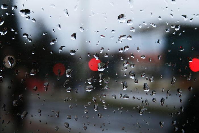 Waiting for the bus 🚃 Rain Rainy Days☔ Rainy Rain In The City Window Through The Window Rain Drops Rain On The Window Rain On Glass Red Light