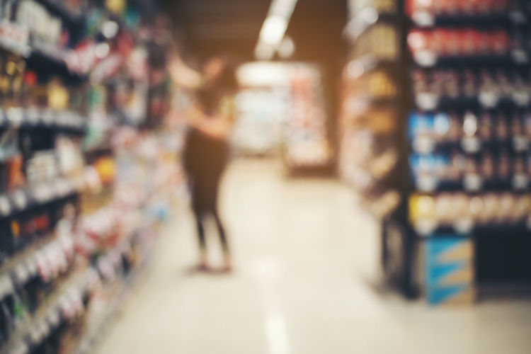 Blurred image of man standing at store