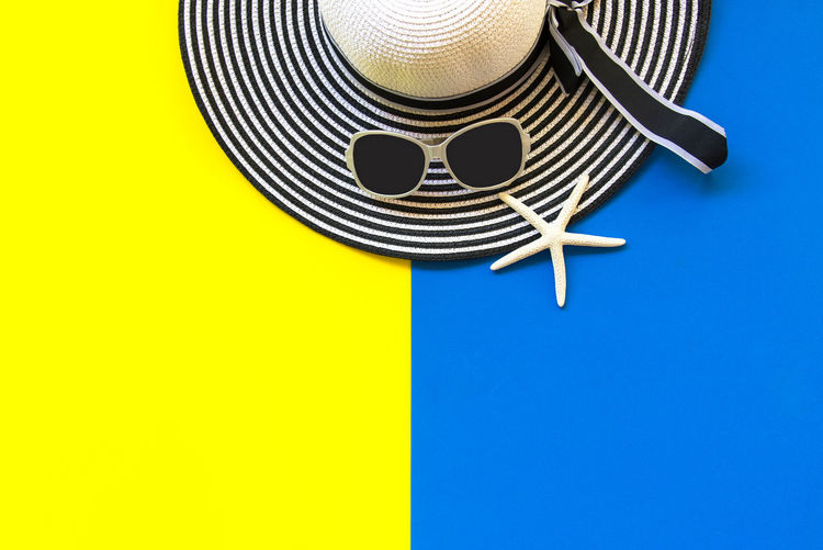 High angle view of electric lamp against blue background