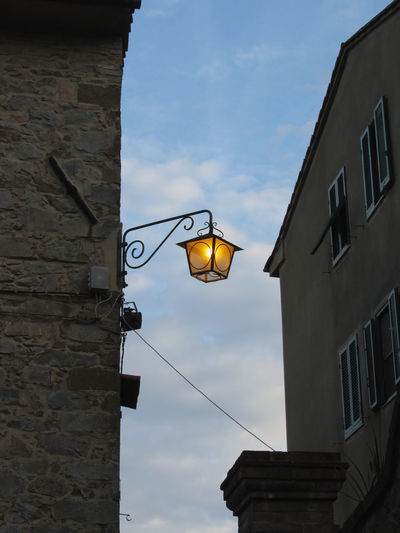 Vintage street lamp in medieval village at twilight. Tuscany, Italy Antique Classic Creepy Dodgy  Electricity  Halloween Iron Italy Lamp Lantern Lighting Equipment Medieval Mysterious Mystery Old Old-fashioned Scary Silhouette Spooky Style Tuscany Twilight Village Vintage Witching
