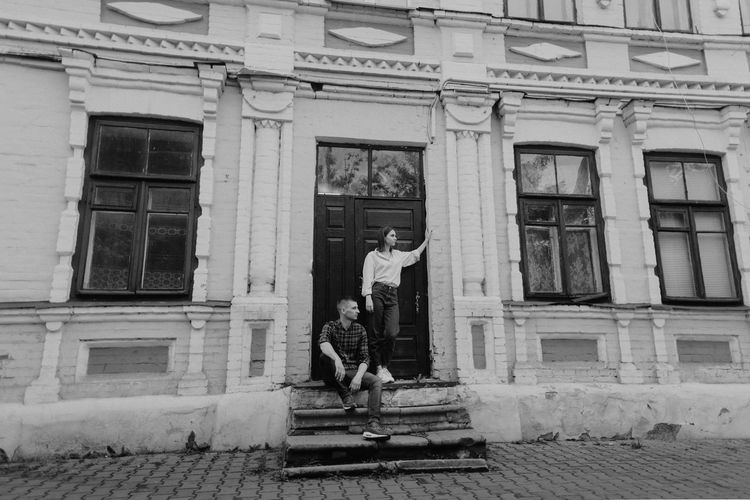 Couple standing at building entrance
