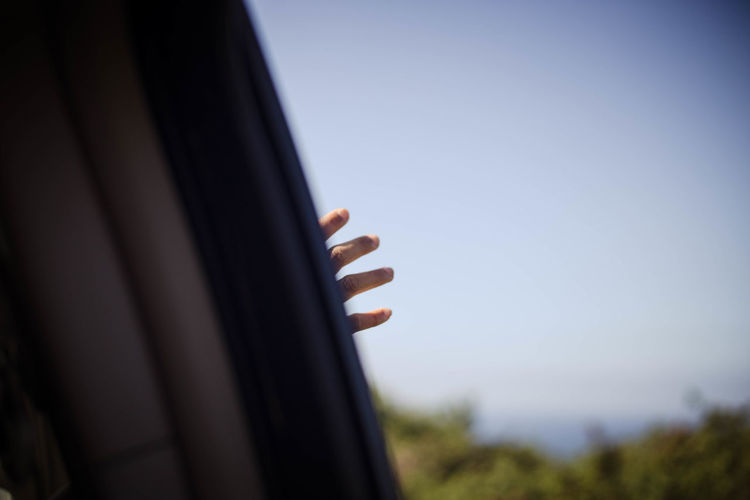 Close-up of hand against clear sky
