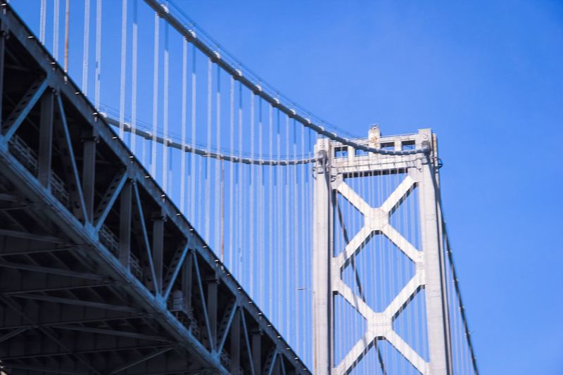 Low Angle View Of Bay Bridge Against Clear Blue Sky