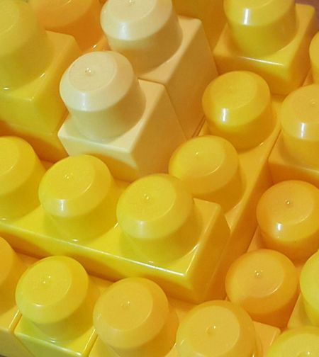 Close-up, Top view of childrens toy blocks. Close-up Large Group Of Objects Yellow Full Frame No People First Eyeem Photo Geometric Shapes Abstract Macro Childs Toy Stacked Geometric Art