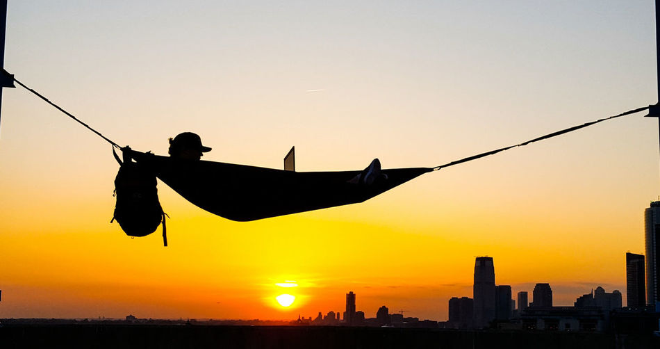 Working Sunset. It's something when you come across a scene like this one in NYC. When everything seems to be in the right place at the right time. Good photography is a little luck and skill. I think this photo incorporates them both in the Urban Jungle. Sunset Sunset Silhouettes Man Laptop Working Hammock Hammock Buildings & Sky New York City Great Outdoors Relaxing Work Flow Work Hard Play Hard New York City Life Rei Outdoor Photography Outdoors Working Outdoors