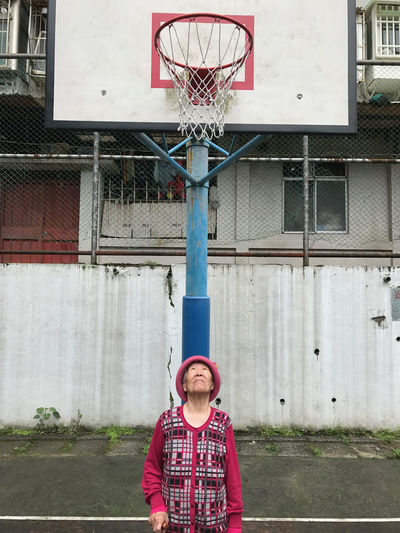 Basketball Basketball - Sport Basketball Game Basketball Hoop Basketball Player Court Day Front View Leisure Activity Lifestyles One Person Outdoors People Portrait Real People Sport Standing Break The Mold Out Of The Box