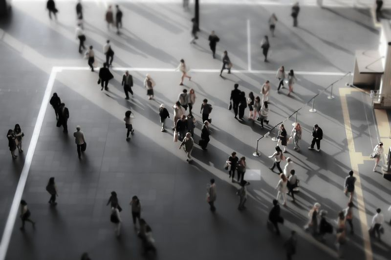 Tilt-shift image of people walking in airport building