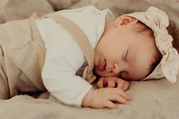 Cute baby sleeping on bed