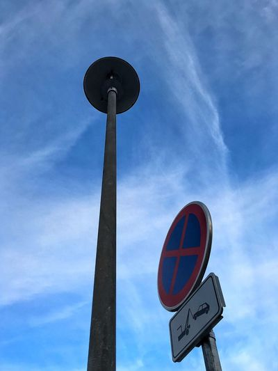 Blue Winter Sky Lamppost Monday Signs Traffic Sign Blue Monday Blue Sky Low Angle View Communication Road Sign Circle Sky Day Guidance Blue No People Outdoors Mobility In Mega Cities