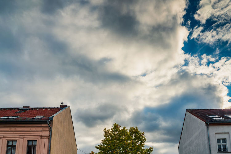 Cloud - Sky Architecture Building Exterior Built Structure Sky Building Tree House Nature Low Angle View Plant Residential District No People Day Roof Outdoors Overcast High Section City Ominous The Creative - 2019 EyeEm Awards