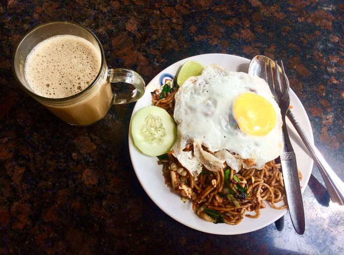 fried noodle with coffee for lunch Holiday Malaysian Food And Drink Egg Food And Drink Breakfast Food Plate High Angle View Fried Egg Healthy Eating Coffee Cup Table Coffee - Drink Fried No People Ready-to-eat Freshness Directly Above Drink Indoors  Egg Yolk Sunny Side Up