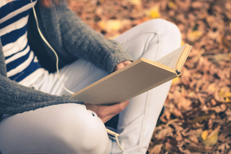 Autumn Learning Student Woman Autumn Book Casual Clothing Caucasian Education Holding Human Hand Leisure Activity Lifestyles Literature Nature One Person Outdoors Publication Reading Reading A Book Relaxation