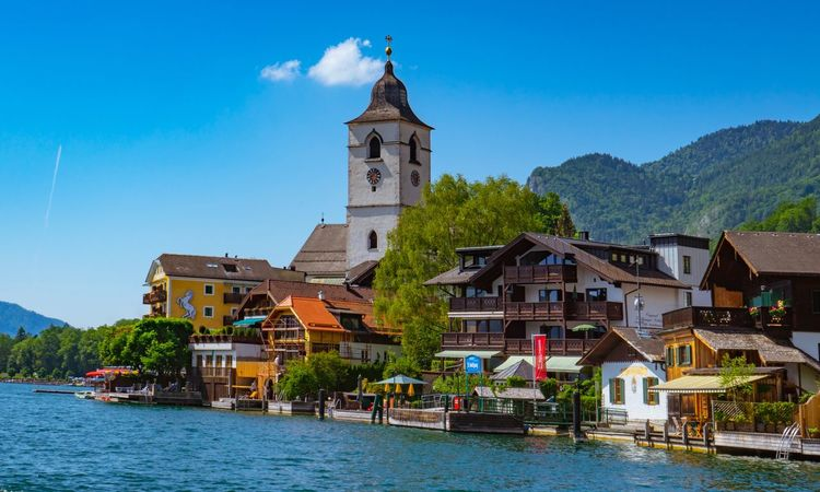 Tranquillity on the Lake Europe European  Lake Town Austria Architecture Built Structure Building Exterior Water Building Sky Religion Tower Nature Spirituality Blue Travel Destinations Outdoors Waterfront No People The Traveler - 2018 EyeEm Awards