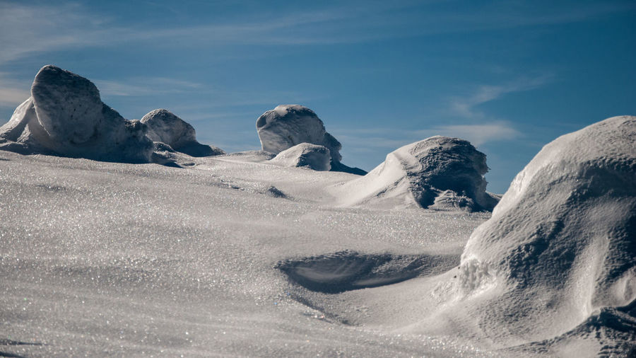 Wavy snowdrifts Sky Beauty In Nature Scenics - Nature Cloud - Sky Winter Nature Tranquility Cold Temperature Environment Tranquil Scene Landscape Day Snow Non-urban Scene No People Land Idyllic Frozen Rock Snowcapped Mountain Snowdrift Minimalism Patterns In Nature Winter Trees Hiking
