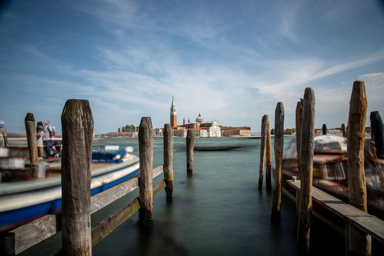 Panoramic shot of wooden post in sea against sky in venice, italy