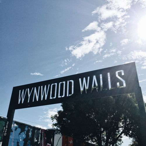 The sign 👌🏼 Wynwood Wynwoodwalls Wywoodwallssign Wynwood Art Walk Text Low Angle View Sky Day Outdoors Communication No People Tree Architecture Miami