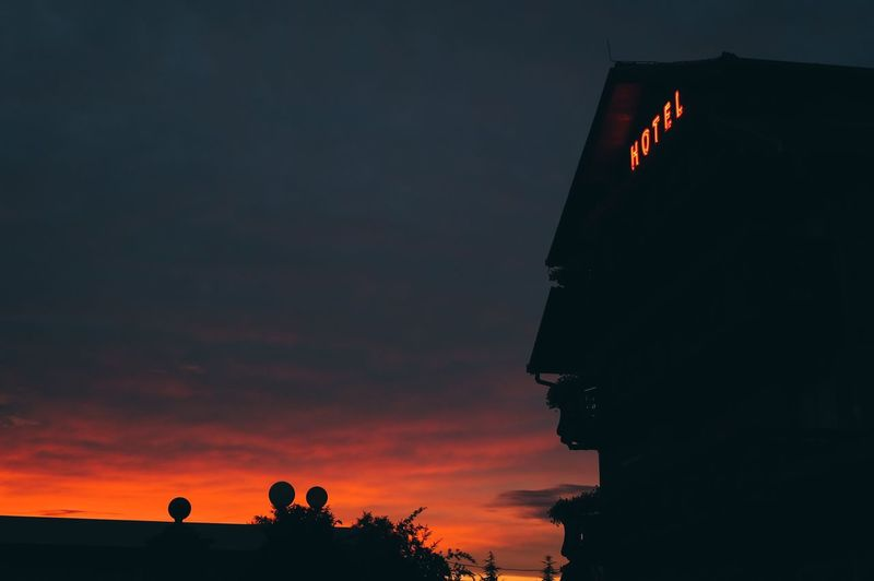 Sunset hotel Sunset Silhouette Flag Sky Low Angle View No People Outdoors Cloud - Sky Nature Beauty In Nature Architecture Day Hotel Red The Great Outdoors - 2017 EyeEm Awards Adventures In The City