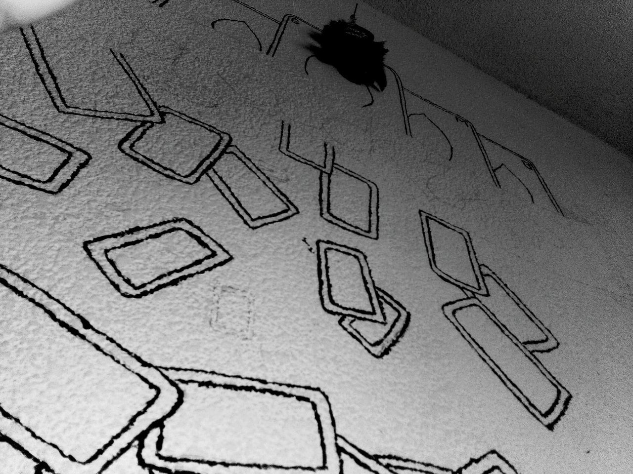 indoors, high angle view, sketch, paper, no people, animal themes, technology, close-up, day