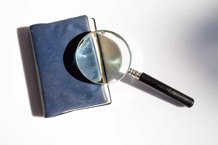 Old magnifying glass with old notebook isolated on white background, Light and Shadow Circle DiaryOfADreamer∞ Isolated Magnification Medical Equipment Memories Old Notebook Paper View Read Close-up Detective Diary Education Eyesight Glass - Material Look Loupe Macro Magnifying Glass Notebook Old Paper Still Life Text Messaging White Background