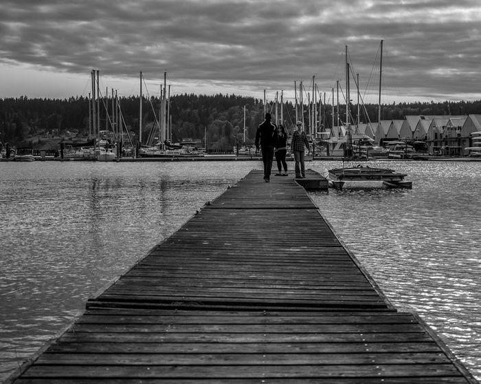 """Meeting on the pier"" Streetphotography Poulsbo Portofpoulsbo EyeEm Best Shots Eye4photography  Hidden Gems  Monochrome Cloud Porn Bay Nature"