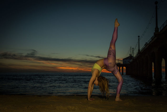 Outdoors Yoga Practice Balance Beach Beauty In Nature Bending Over Backwards Concentration Day Exercising Flexibility Full Length Handstand  Healthy Lifestyle Leisure Activity Lifestyles One Person Outdoors Practicing Real People Skill  Sky Strength Upside Down Vitality Yoga Yoga Young Women