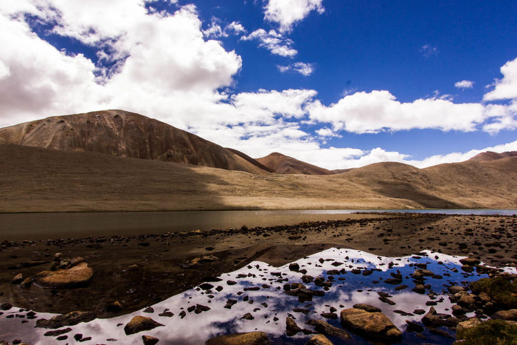 Mountain Tranquil Scene Scenics Lake Tranquility Sky Water Non-urban Scene Mountain Range Cloud - Sky Beauty In Nature Majestic Nature Cloud Cloudy Travel Destinations Blue Outdoors Landscape Day Tourism Reflection Sikkim Himalayas