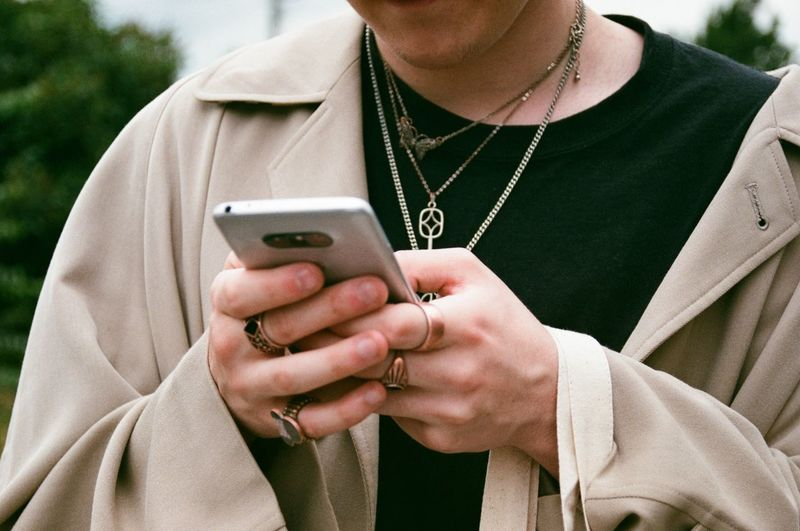 35mm🌿 Chains Style Rings Streetwear Tan Urban EyeEm Selects Wireless Technology Midsection Communication Mobile Phone Connection Technology Smart Phone Portable Information Device Holding Text Messaging One Person Telephone Using Phone Close-up Front View Lifestyles Day Adult Real People Form Of Communication