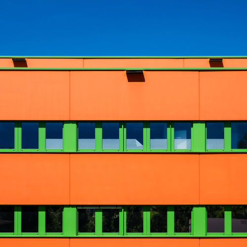 Blueskybuildingdetail Architecture Blue Built Structure No People Fujix_berlin Ralfpollack_fotografie Minimalism Minimal Multi Colored Orange Color Outdoors Modern In A Row Building Building Exterior Industry Façade