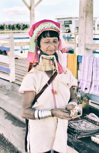 Ethynic Group Padaung My Eyes On MYanmar Day Gold Collars Lifestyles Occupation One Person Outdoors Portrait Real People Woman Portrait Working Young Adult