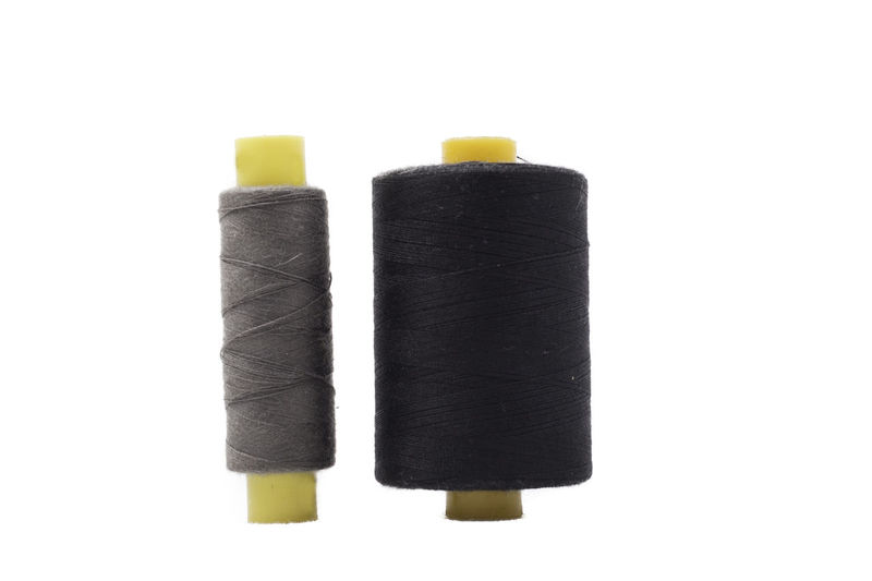 Spools of thread isolated on white background Dark Isolated Needlework Sewing Sewing Stuff Tailor Art Background Black Cloth Craft Creative Fabric Grey Handmade Item Kit Multi Colored Needle Spool Spool Of Thread Textile Thread White White Background