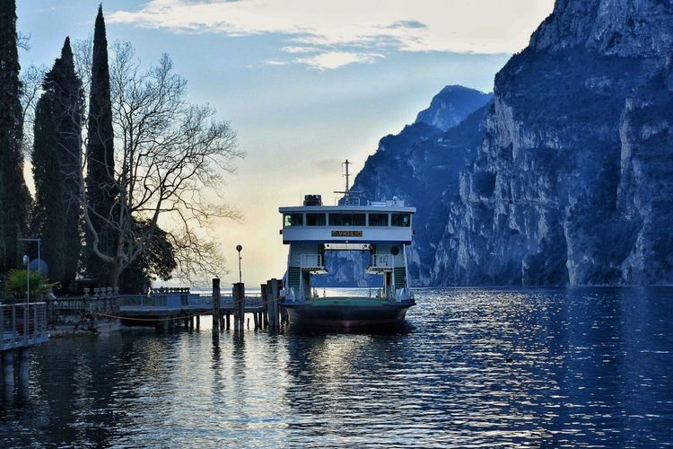 Water Waterfront Built Structure Reflection Nautical Vessel Sky Architecture Nature Sea Building Exterior Mode Of Transport Scenics Travel Destinations Beauty In Nature Transportation No People Tranquility Outdoors Moored Tranquil Scene Reflection Sunset EyeEm Gallery Riva Del Garda Love ♥
