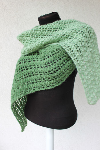 Close-up of green wool over white background