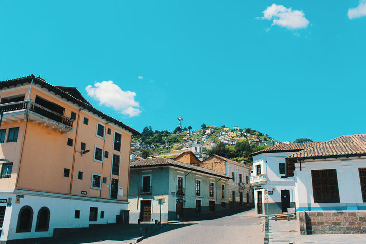 Exterior of buildings in town against blue sky