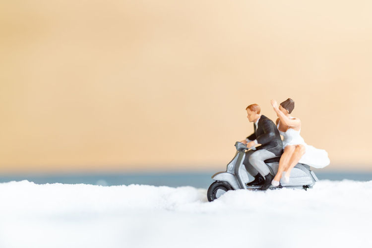 Rear view of couple sitting against sky
