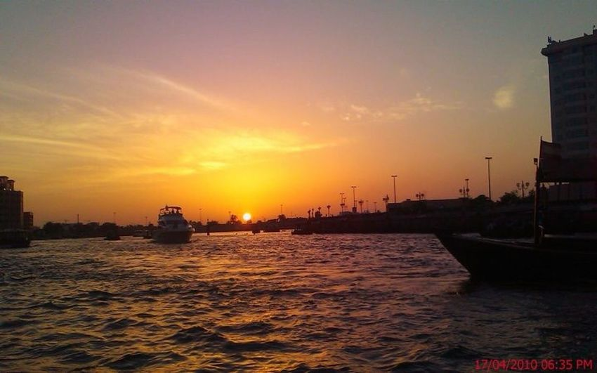 Sunset Dubai Creek Sunset Dhow Dubai Creek Sunset Architecture Sky Orange Color Nautical Vessel Building Exterior Built Structure Travel Destinations Water Mode Of Transport Sun Transportation Waterfront Nature City Beauty In Nature Cloud - Sky Sea
