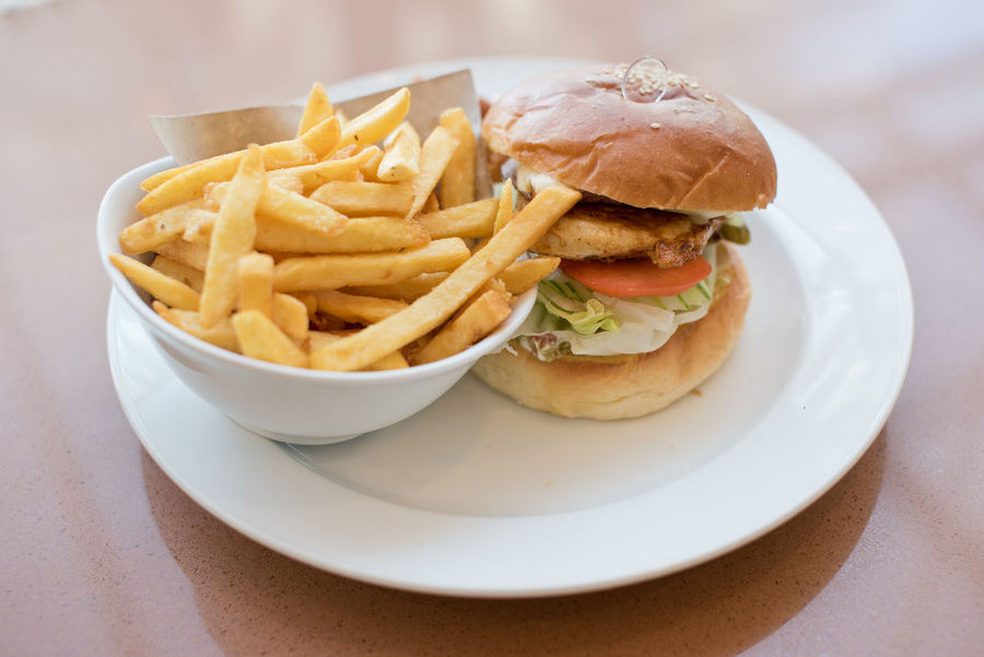 chicken burger and fries Burger Chicken Burger Close-up Comfort Food Deep Fried  Fast Food Food French Fries Freshness Grilled High Angle View Indoors  Indulgence Meal No People Plate Prepared Potato Ready-to-eat Served Serving Size Table Tasty Temptation Unhealthy Eating