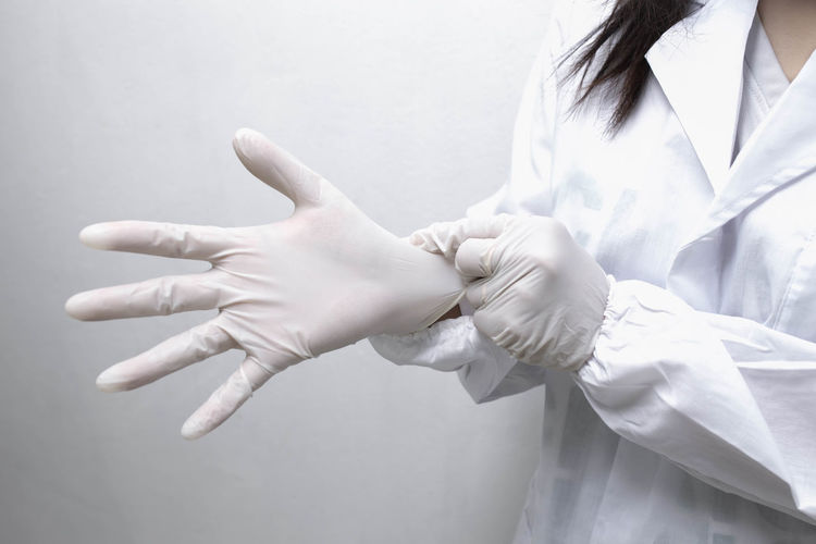 Close-up of woman hands over white background