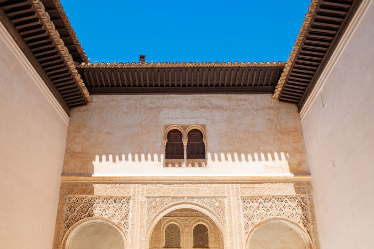 Alhambra (Granada) Alhambra De Granada  The Week on EyeEm Arch Architecture Building Exterior Built Structure Classical Style Clear Sky Courtyard  Day History Low Angle View Nature No People Ornate Outdoors Sky Sunlight The Past Tourism Travel Travel Destinations Wall - Building Feature Window