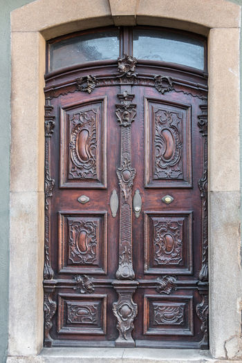 Old door of a historical building with stairway Entrance Door Closed Architecture Building Building Exterior Built Structure Safety Day Protection No People Security Wood - Material Design Front Door Art And Craft Outdoors Craft Pattern Wood Ornate Carving Bas Relief