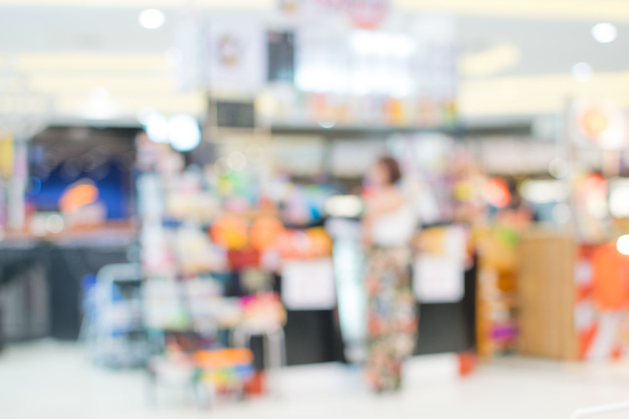 standing, choice, store, indoors, retail, adult, people, business, for sale, incidental people, variation, focus on foreground, sale, small business, illuminated, defocused, real people, selective focus, shopping, men, retail display, uniform, consumerism