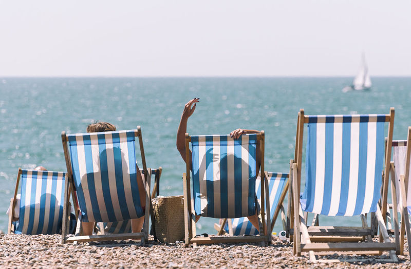 Summer Holidays Chilling EyeEm Best Shots EyeEm Nature Lover EyeEm Selects EyeEm Gallery Holiday Holidays Relaxing Summertime Travel Photography Beach Beach Chair Beach Chairs Blue Chair Sailboat Sea Shadow Shadows Summer Sunbathing Tranquility Travel Destinations Summer Exploratorium Focus On The Story #FREIHEITBERLIN A New Perspective On Life Human Connection Capture Tomorrow Moments Of Happiness