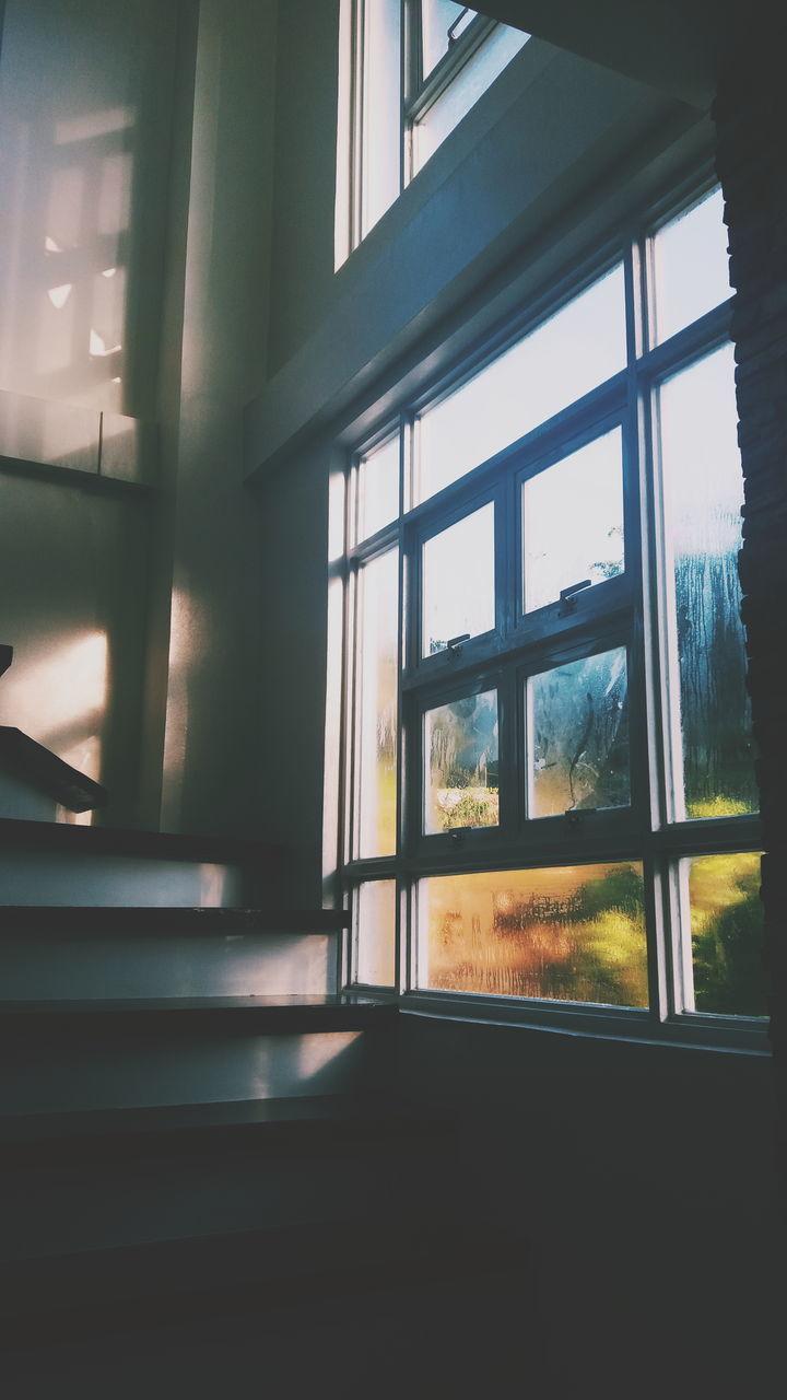 CLOSE-UP OF SUNLIGHT STREAMING THROUGH WINDOW