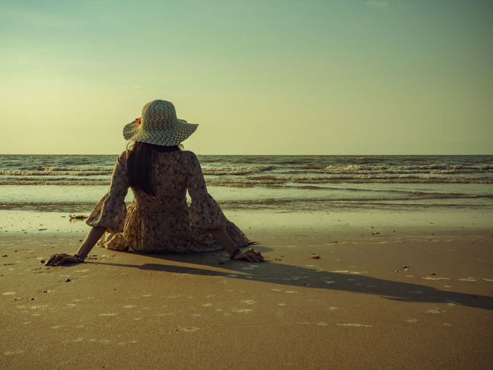 This summer, let's go to the sea. Sea Beach Land Water Sky Horizon Over Water Horizon Beauty In Nature Scenics - Nature Sand Tranquil Scene Tranquility Nature One Person Rear View Hat Clear Sky Real People Vacations Outdoors Hairstyle