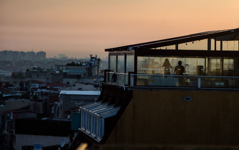 Couple Rooftop Silhouettes Sunset Silhouettes Sunset_collection Architecture Building Exterior Built Structure City Cityscape Clear Sky Day Nature Outdoors Rooftop View  Sky Sunset Urban