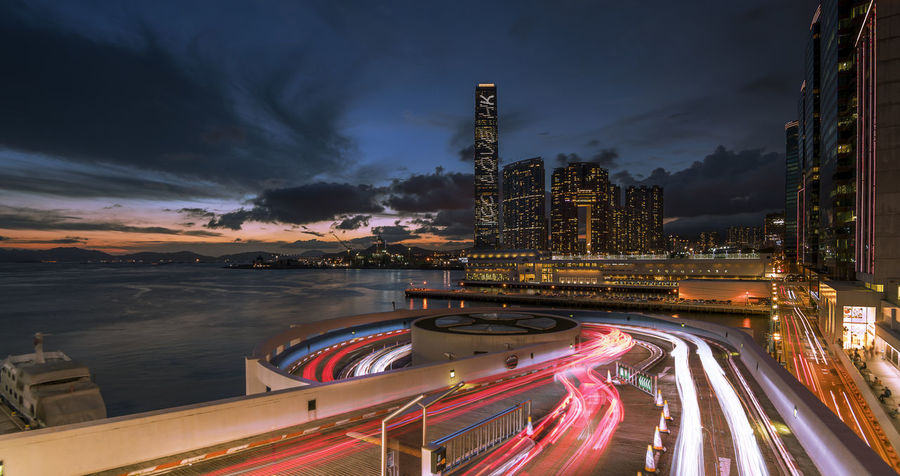 Hong Kong at Night Architecture Blurred Motion Bridge - Man Made Structure Building Exterior Built Structure City Cityscape Cityscape Cloud - Sky High Street Hong Kong Illuminated Light Light Trail Long Exposure Motion Night No People Outdoors Road Sky Speed Transportation Victoria Harbor Water