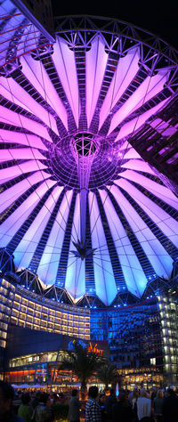 The Sony Center is a JAHN designed Sony-sponsored building complex located at the Potsdamer Platz in Berlin, Germany. It opened in 2000 and houses Sony's German headquarters. The site was originally a bustling city centre in the early 20th century. Most of the buildings were destroyed or damaged during World War II. From 1961 on, most of the area became part of the No Man's Land of the Berlin Wall, resulting in the destruction of the remaining buildings. After the fall of the Berlin Wall on 9 November 1989, the square became the focus of attention again, as a large (some 60 hectares), attractive location which had suddenly become available in the centre of a major European capital city. As part of a redevelopment effort for the area, the center was constructed. The centre was designed by Helmut Jahn and Peter Walker as landscape architect and construction was completed in 2000 at a total cost of €750M. Berlin City Lights At Night Modern Architecture Night Lights Sony Center Sony Center Berlin Travel Photography Architecture Arts Culture And Entertainment Built Structure City City Landscape City Lights Famous Place Germany Illuminated Low Angle View Night Potzdamer Platz Sony Travel Destinations Travelphotography Vertical Vertical Panorama