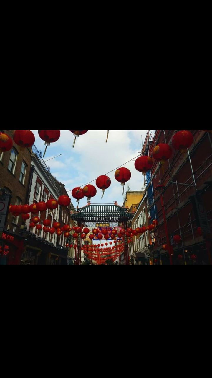 built structure, architecture, hanging, chinese lantern, low angle view, building exterior, cultures, lantern, celebration, outdoors, city, no people, sky, day