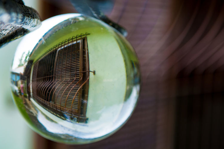Reflection of house on crystal ball