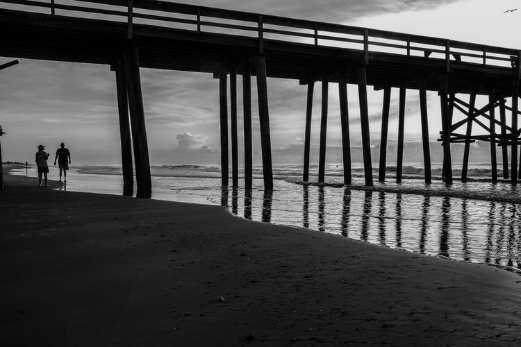 Beachphotography Beach Beach Photography Reflection Tide Water People Watching Streetphotography People Photography Old Pier Landing Walkway Diminishing Perspective Cloudporn Clouds And Sky Sweet My Favorite Place Welcome To Black Art Is Everywhere BYOPaper! Blackandwhite Exceptional Photographs Bestoftheday Photo Of The Day