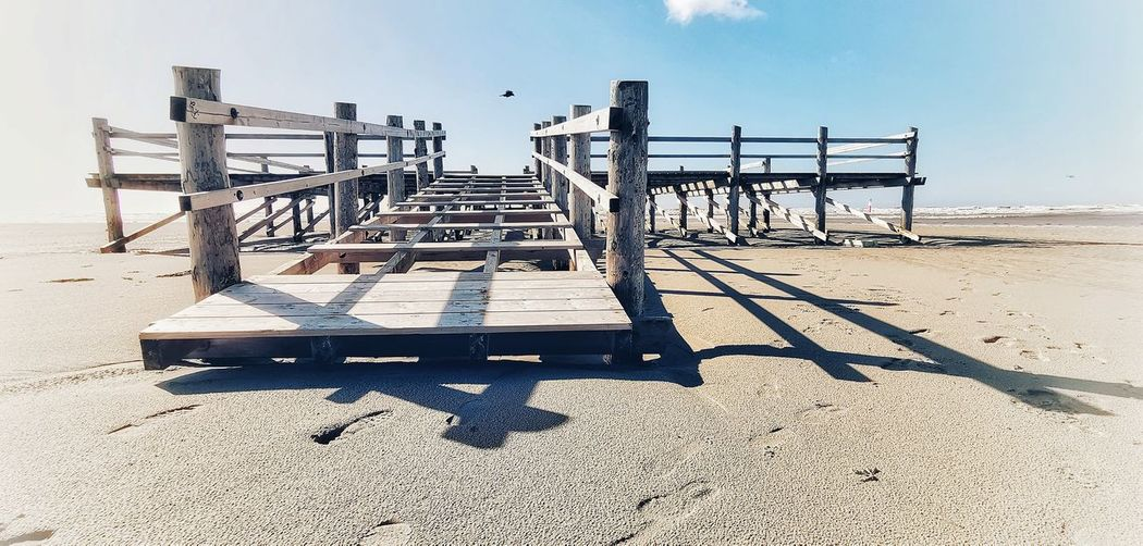 Tranquil Scene Tranquillity Seascape Sea And Sky Beach Photography Beach Day Wood Wood - Material Wooden Bridge No People Non-urban Scene Sky And Clouds Water Waterfront Sea Beach Shadow Sand Sunlight Sunny Protection Sky Horizon Over Water Lifeguard Hut Lifeguard  Observation Point Wooden Tide Calm